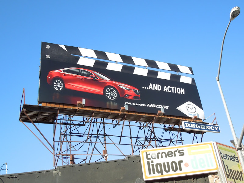 And action clapperboard Mazda billboard
