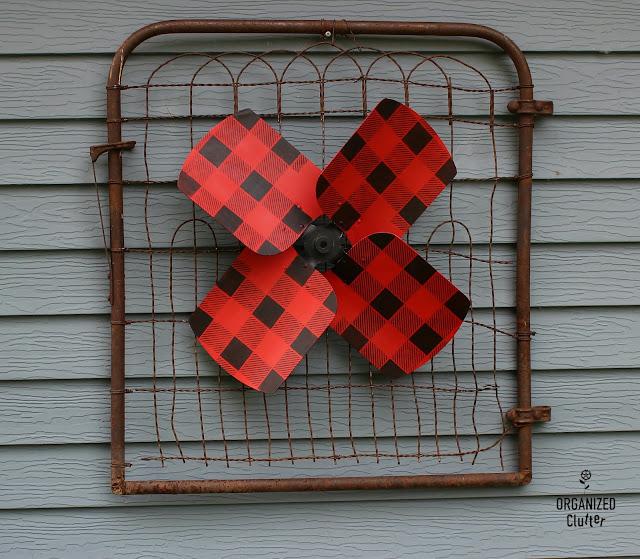 Garage Sale Fan Blade Re-purposed As A Wall Flower #upcycle #repurpose #junkgarden #garagesalefinds #buffalochecks #oldsignstencils #stencil #outdoordecor