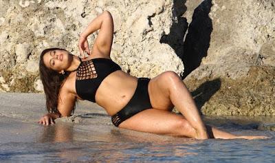 Ashley Graham seductively pulls down her bikini bottoms for sultry shoot