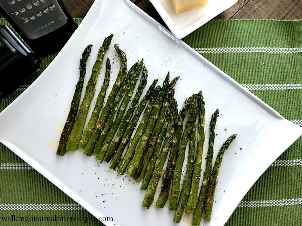 Roasted Asparagus on white tray before Parmesan Cheese from Walking on Sunshine