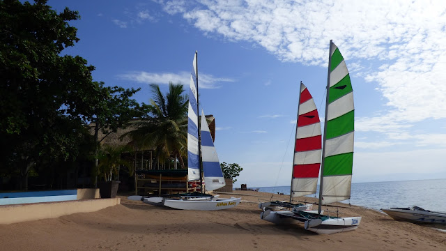 Sailing boats on the golden sand shore of Lake Malawi - Danforth Yachting
