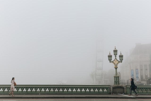 Walking on a misty road