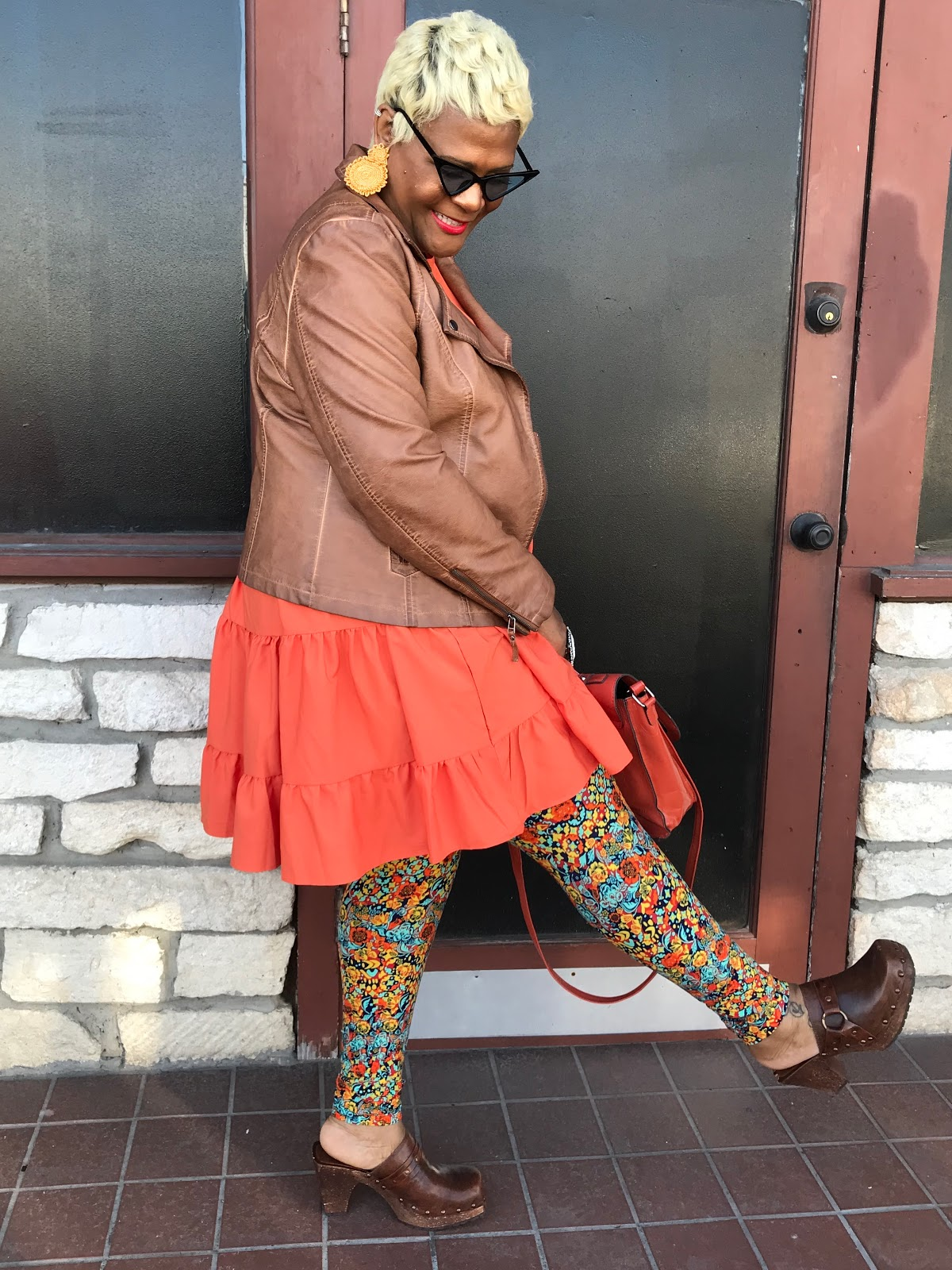 What I wore today: orange baby doll dress, colorful leggings, leather jacket and orange handbag.