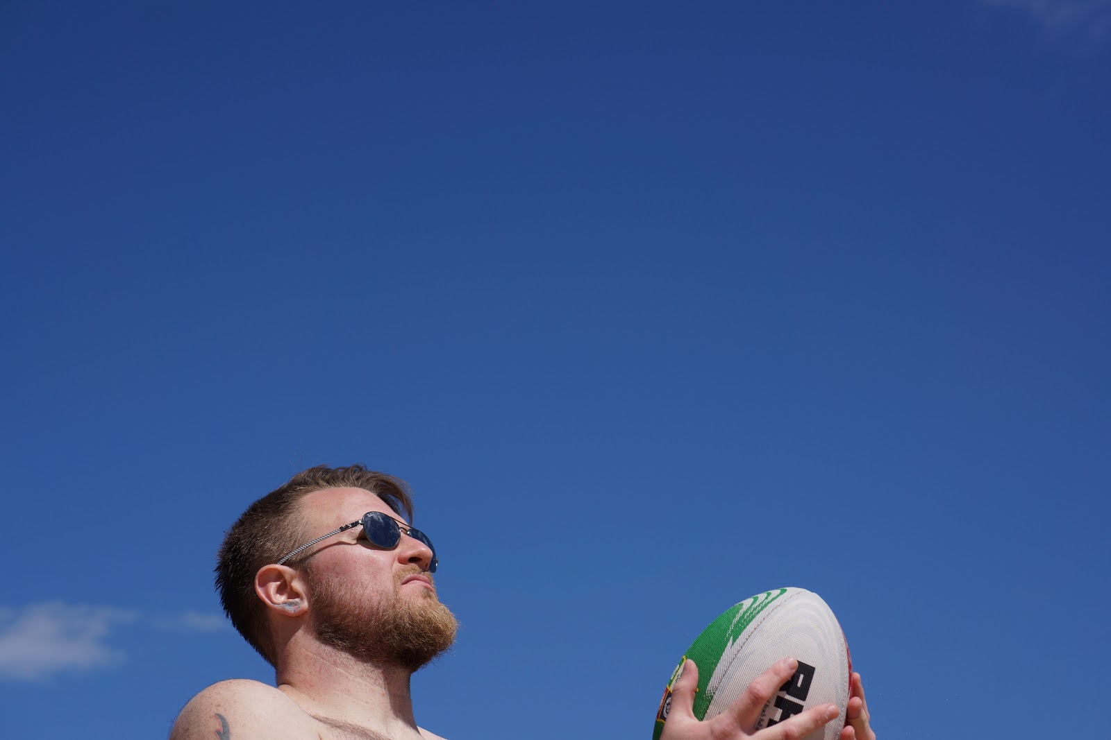 man throwing a rugby ball