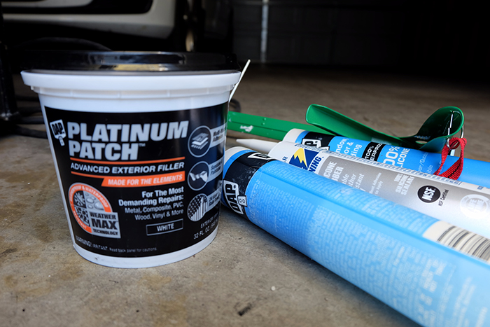 outdoor patch product and tubes of caulk