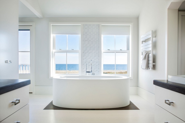 Bathtub in Contemporary style home on the beach
