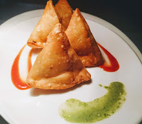 Serving samosa with mint Chutney and tomato ketchup for Samosa recipe