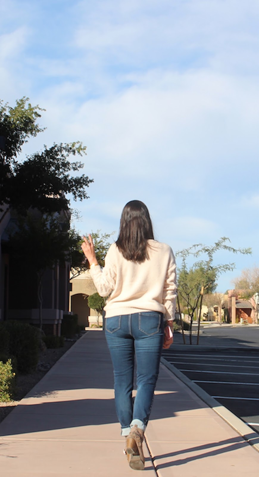 I am hold the peace sign, as I walk away from the camera.