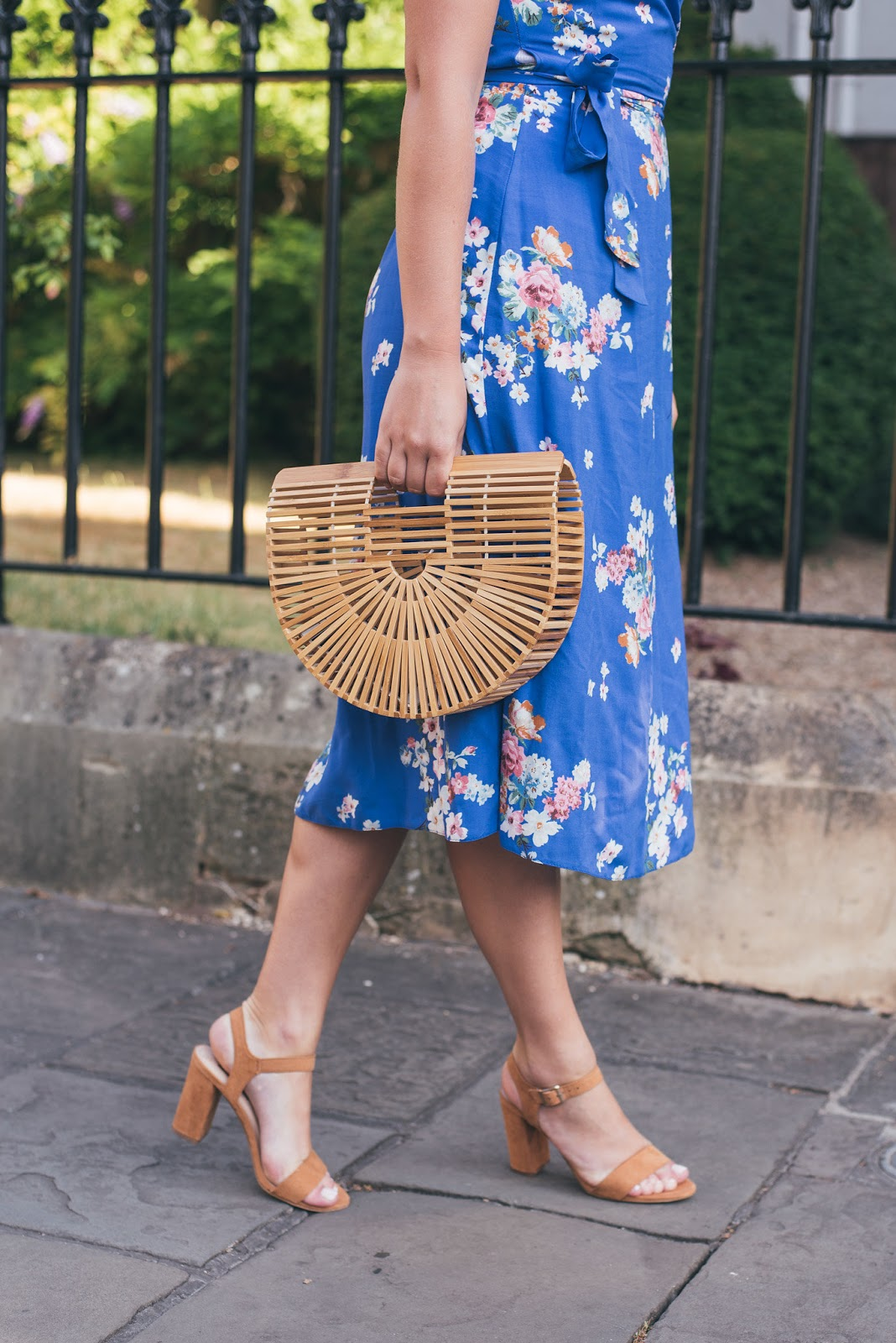 Close up of the bottom of the blue floral primark midi dress with primark tan sandals and PrettyLittleThing Bamboo Halfmoon Bag