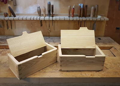 Two wooden boxes on a workbench