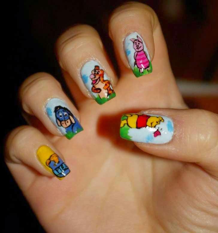 Uñas diseñadas al estilo winnie The pooh nails