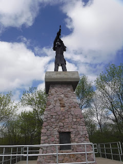 a metal scuplture depicting Chief War Eagle sits atop a stone monument at War Eagle Park in Sioux City, Iowa