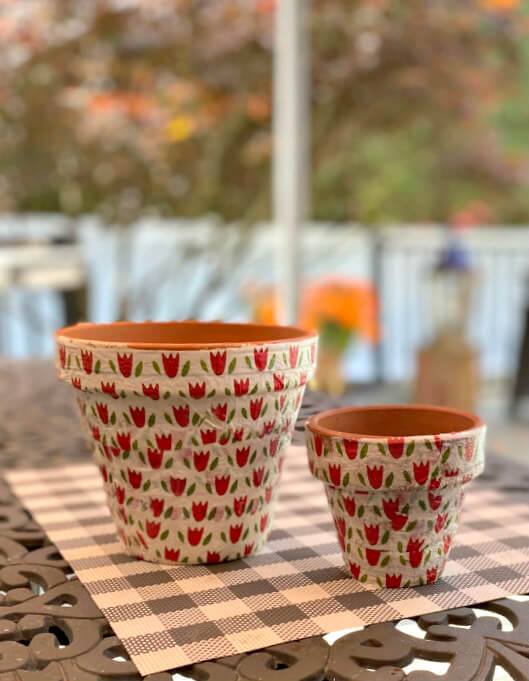 Terra cotta pots decoupaged with red tulip napkins