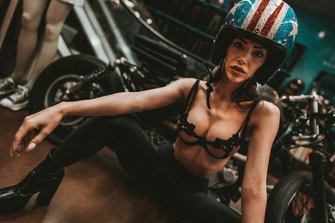 Mya models an open-face helmet with a stars and stripes metalflake paint job.