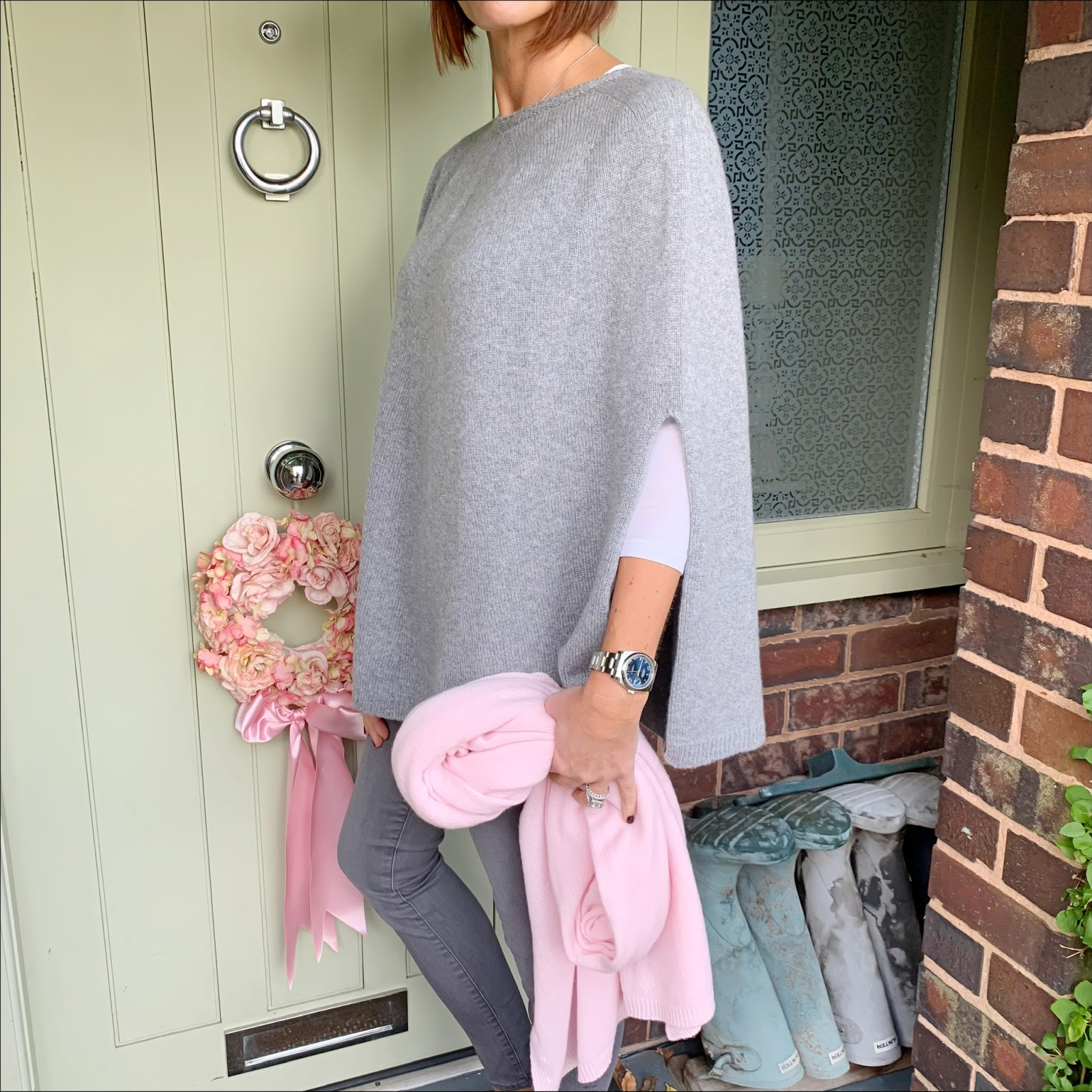 my midlife fashion, italy in cashmere, pure cashmere wrap in baby pink, pure cashmere poncho cape, snakeprint crossbody bag, j crew vintage three quarter sleeve tee, j crew 8 inch toothpick jeans, hush thornton ankle boots