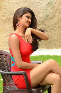 Actress Poojitha  Pictures in Red Short Dress at Bullet Movie Opening  0112