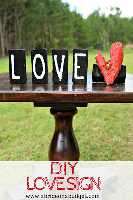 Wedding signs are SO popular! But you don't have to buy them all. You can make your own. Find out how to make this DIY LOVE sign at www.abrideonabudget.com.
