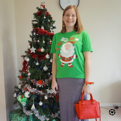 awayfromblue Instagram | casual Christmas eve outfit festive Santa glitter tee with gold bauble earrings and red rebecca minkoff bag
