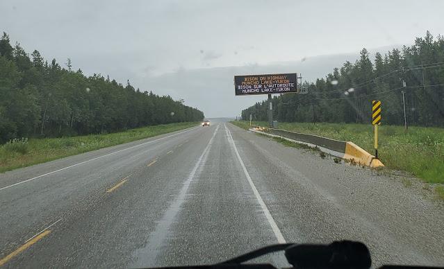 Warning sign on Alaska highway in British Columbia