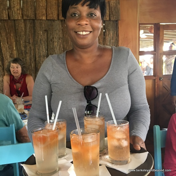 guide Monica helps serve drinks at Blue Crab Restaurant in Scarborough, Tobago