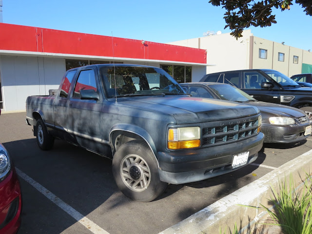 Old, faded paint on 1993 Dodge Dakota before complete repaint at Almost Everything Auto Body.