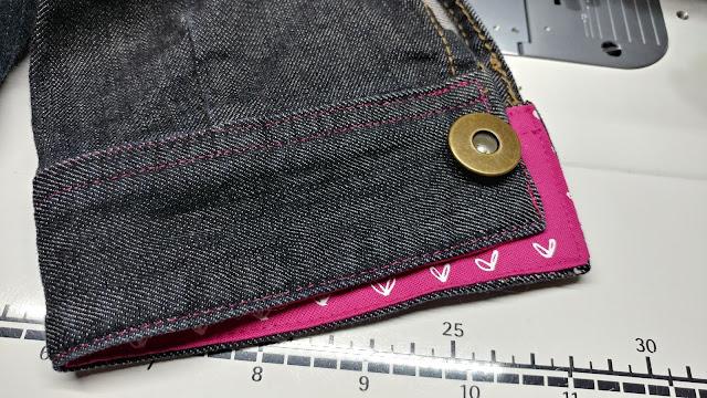 Hot pink Aurifil thread on upcycled denim jacket