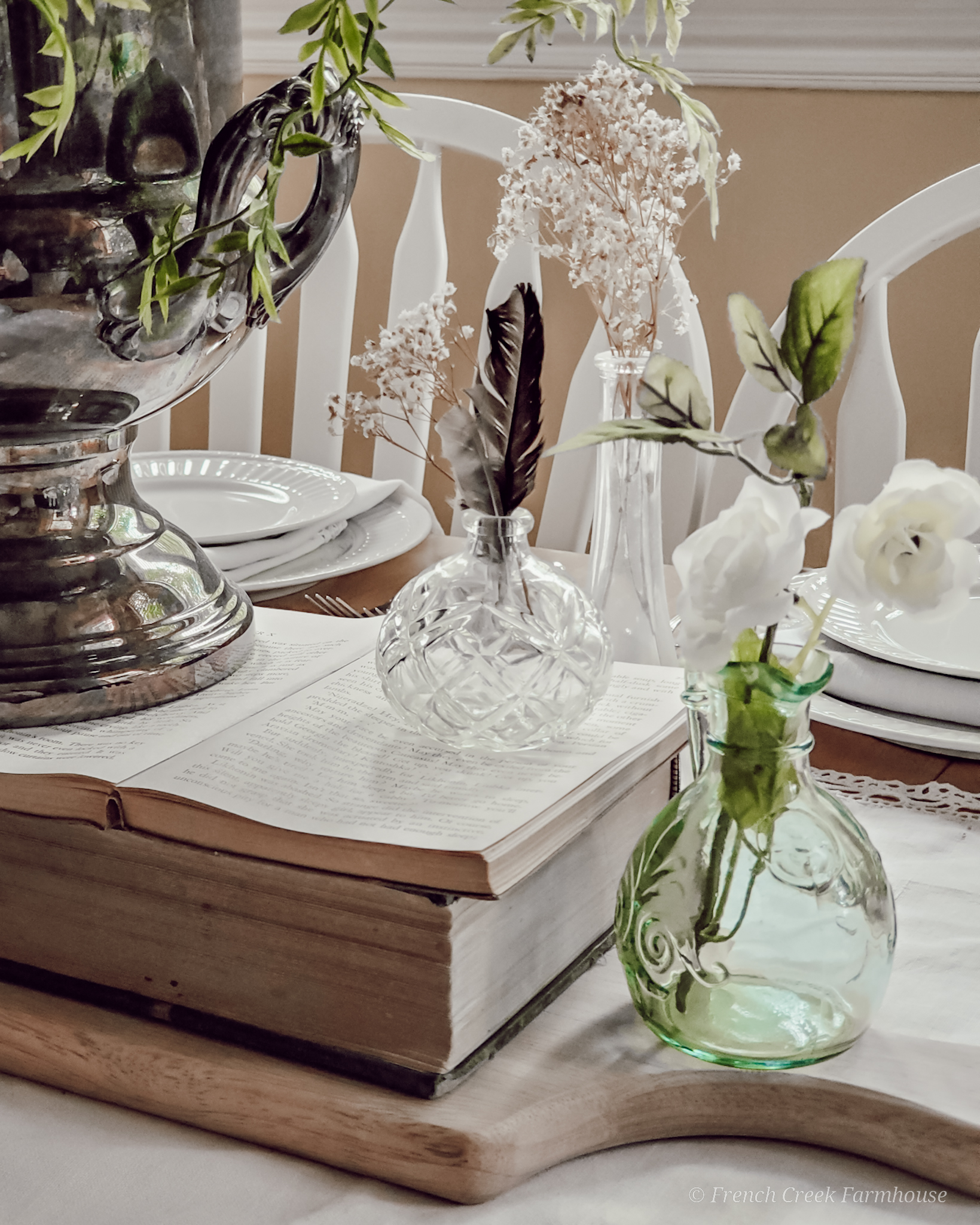 Small vintage vases and old books used for a romantic centerpiece