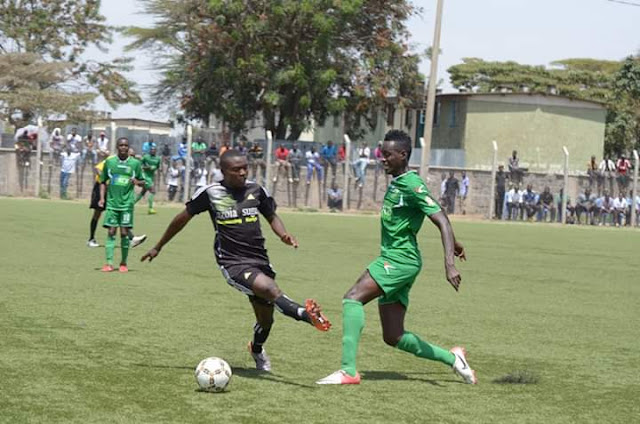 A midfield player dribbling an opponent on a Kenyan football pitch