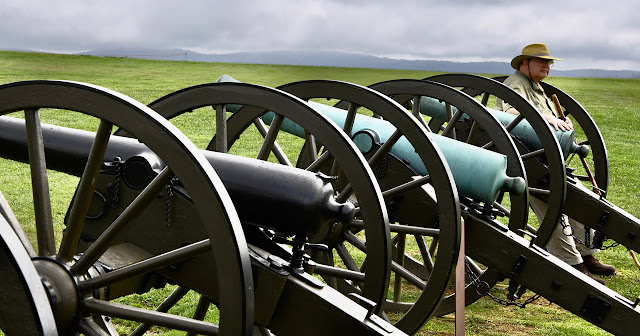 Dr. Dale Smith standing with cannons at Antietam.
