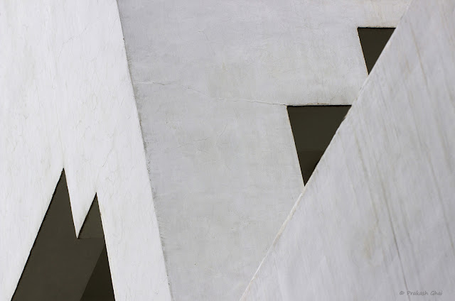 Two Triangles Vs Lines. A multi layer shot of two portions of a building shot via Canon 100mm Prime F2.8 Macro L Series Lens mounted on a Canon 600D Crop Sensor Camera.