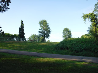 the dog park at Bacon Creek Park is visible from the main parking area