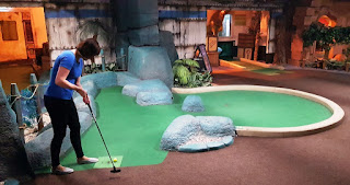 Emily on the Temple Ruins course at Paradise Island Adventure Golf in Manchester