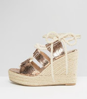 http://www.asos.com/glamorous/glamorous-rose-gold-tie-up-espadrille-wedges/prd/7254809?iid=7254809