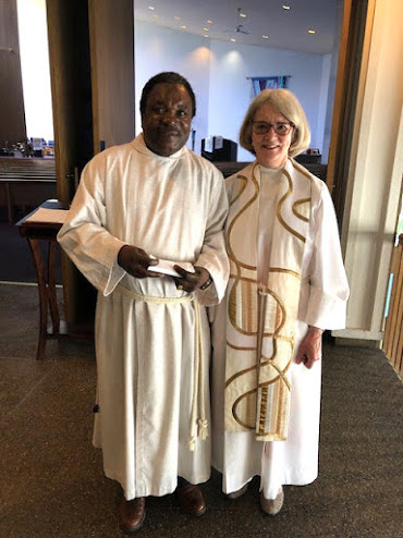 Stanley and Pastor Pam in their church robes.
