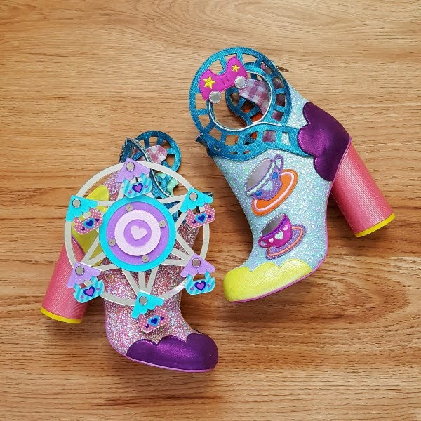 ankle boots on wodden floor with rollercoaster and ferris wheel detail on sides