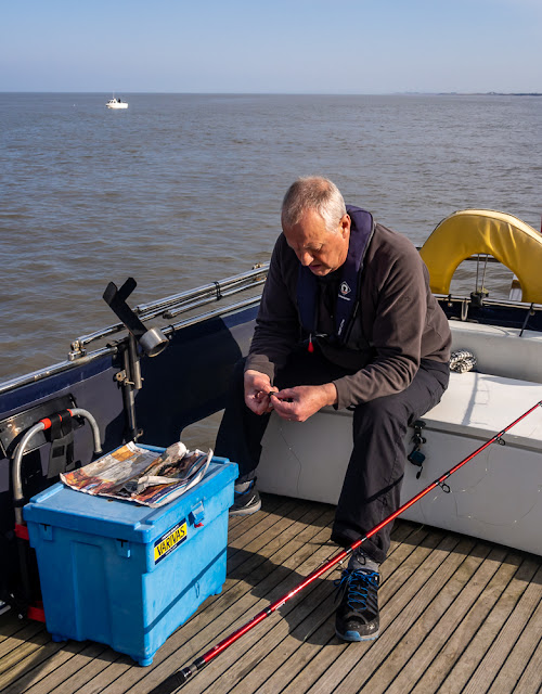 Photo of Phil setting up one of his fishing rods