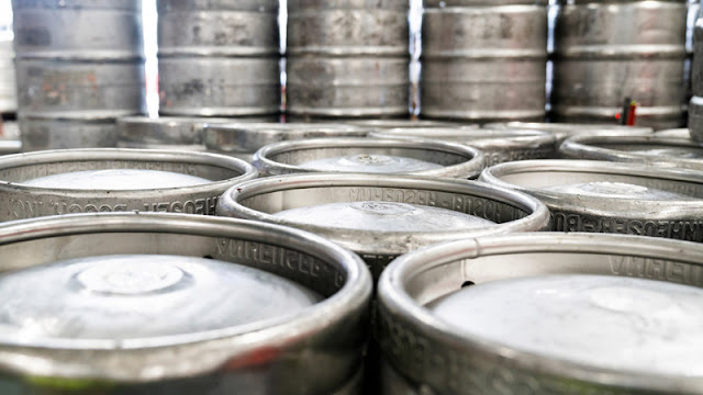 stacks of silver kegs