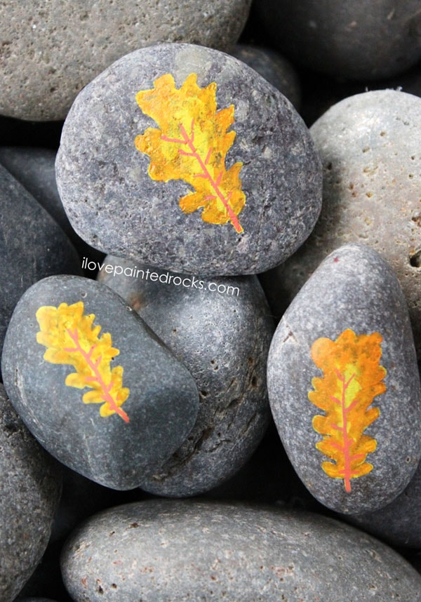 Paint beautiful fall leaves on rocks
