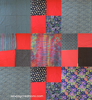 background fabrics dark prints and reds liberated churn dash quilt