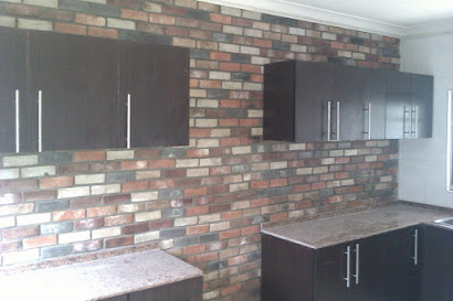 Antique brick tiles on a kitchen wall