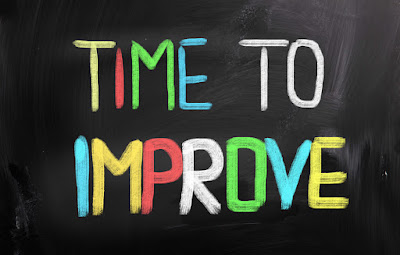 "The words ""Time to Improve"" are printed on a blackboard"
