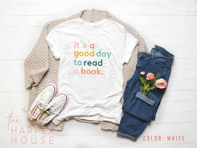 "Fun bookt-themed t-shirt reads ""It's a Good Day to Read a Book."""