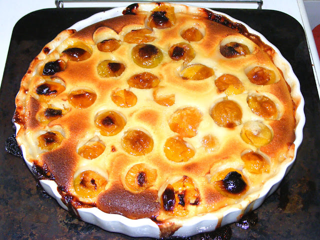 Mirabelle clafoutis. Cooked and photographed by Susan Walter. Tour the Loire Valley with a classic car and a private guide.