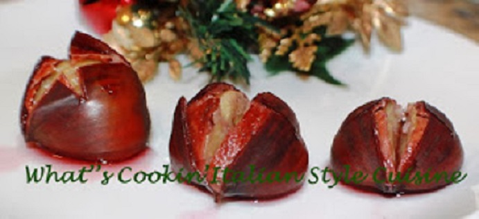 chestnuts on a white plate with christmas holly and in merlot wne