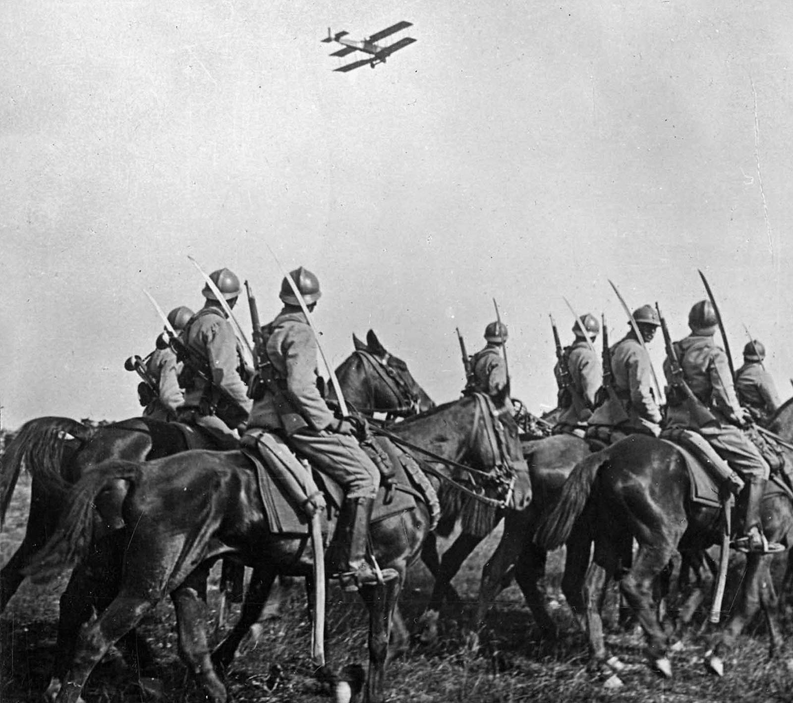 French Cavalry observe an Army airplane fly past, 1916.