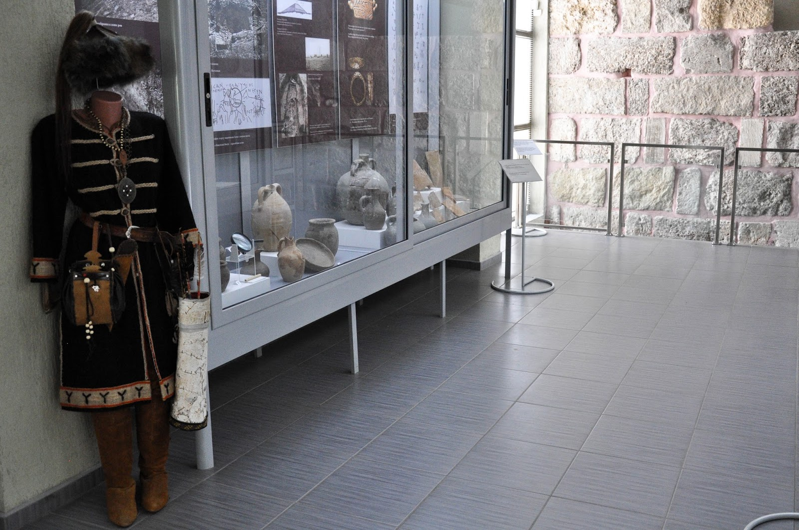 Inside the museum with the old wall with pink mortar visible in the background, Pliska, Bulgaria