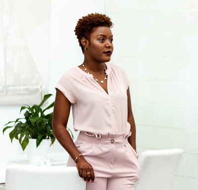 woman business owner standing next to a desk