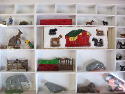 Painted miniature lead toys on display.