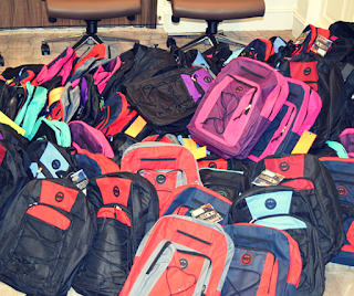 Smart Circle gives backpacks to Orangewood Shelter