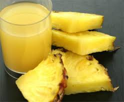pineapple and its juice in a cup